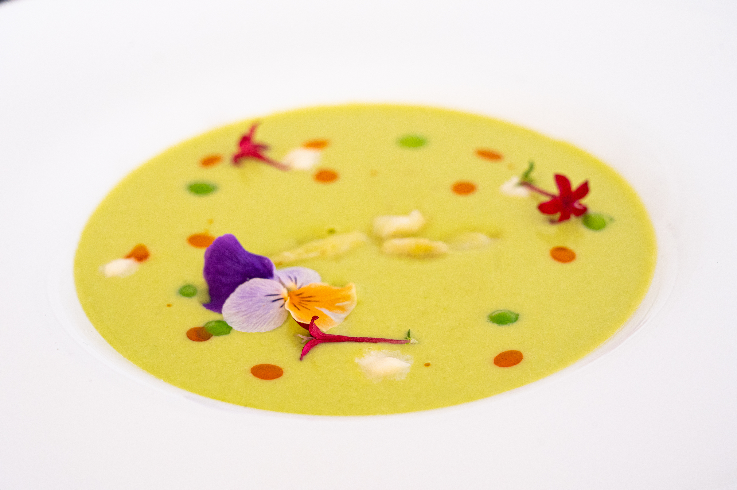 Spring English pea and asparagus soup with farm butter poached lobster and local honey mascarpone