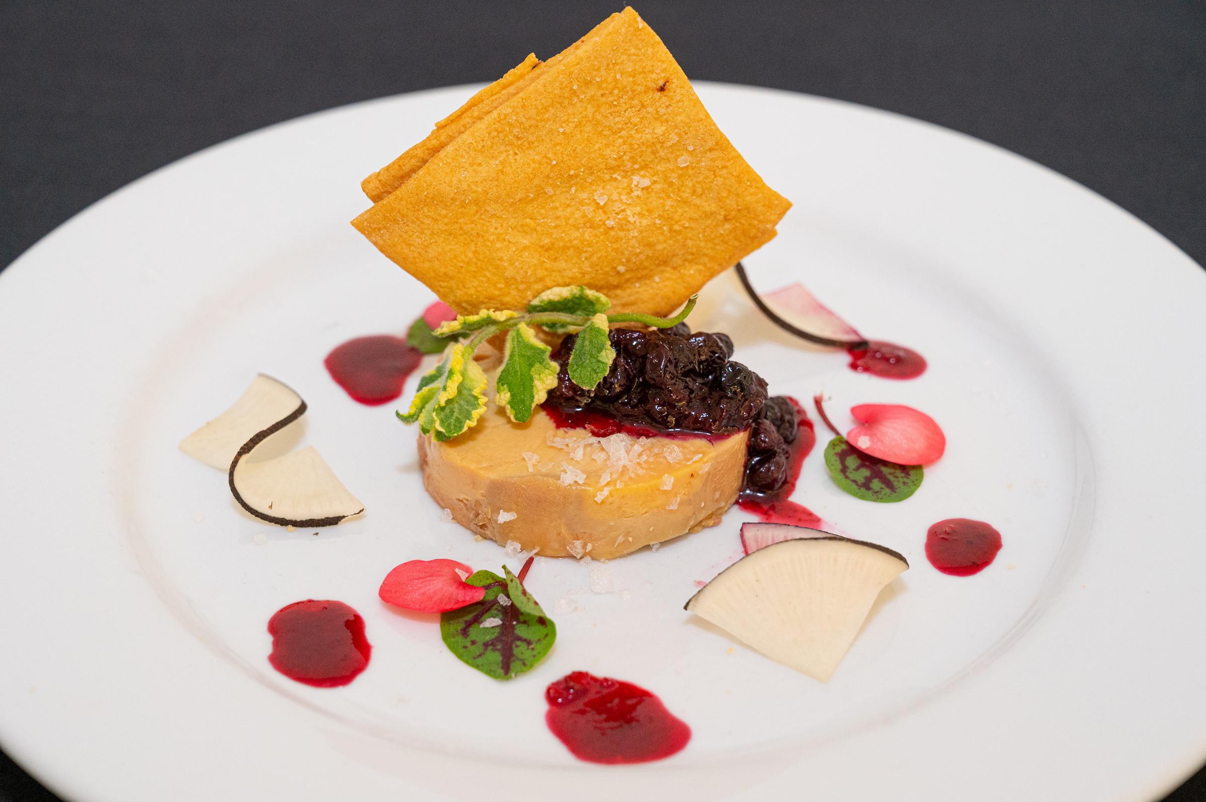 Fois Gras torchon with huckleberry jam, pickled black radish, and sea salt cracker